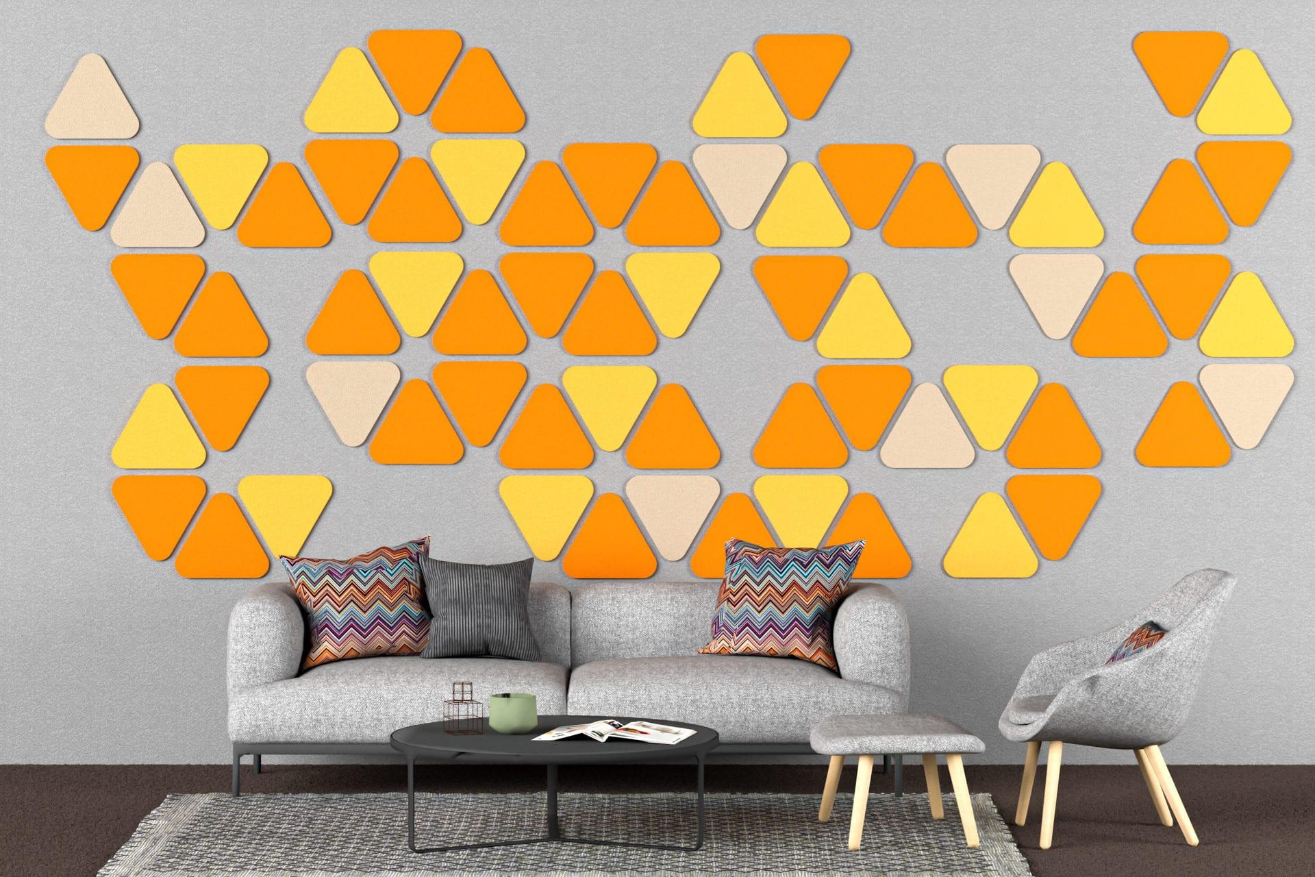 Panele dekoracyjne dźwiękochłonne w kształcie zaokrąglonych trójkątów na ścianie w salonie